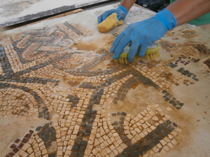 Mosaic cleaning, treatment and consolidation.<br>Image kindly provided by ERA Arqueologia.
